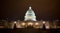 """The lights of the U.S. Capitol remain lit into the night as the House continues to work on the """"fiscal cliff"""" legislation proposed by the Senate, in Washington, on Tuesday, Jan. 1, 2013. (AP Photo/Jacquelyn Martin)"""