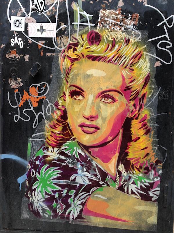 Graffiti stencil portrait of Rita Hayworth in Barcelona