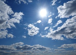 sunny sky with bits of cloud