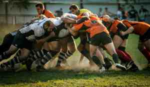 Struggle represented by a rugby scrum