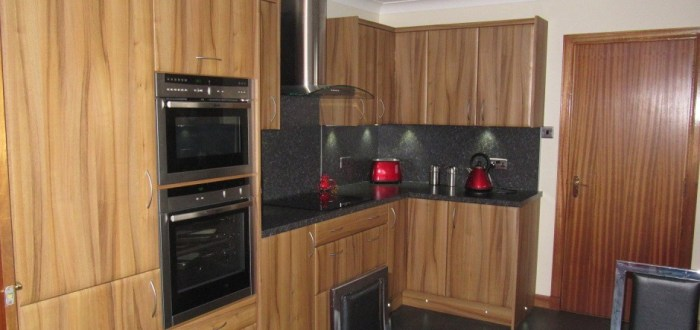 image for Kitchen Design, Supply And Installation Of The Bella Light Walnut  range. By Billy Walker Joinery Services Ltd, Fraserburgh, Aberdeenshire.