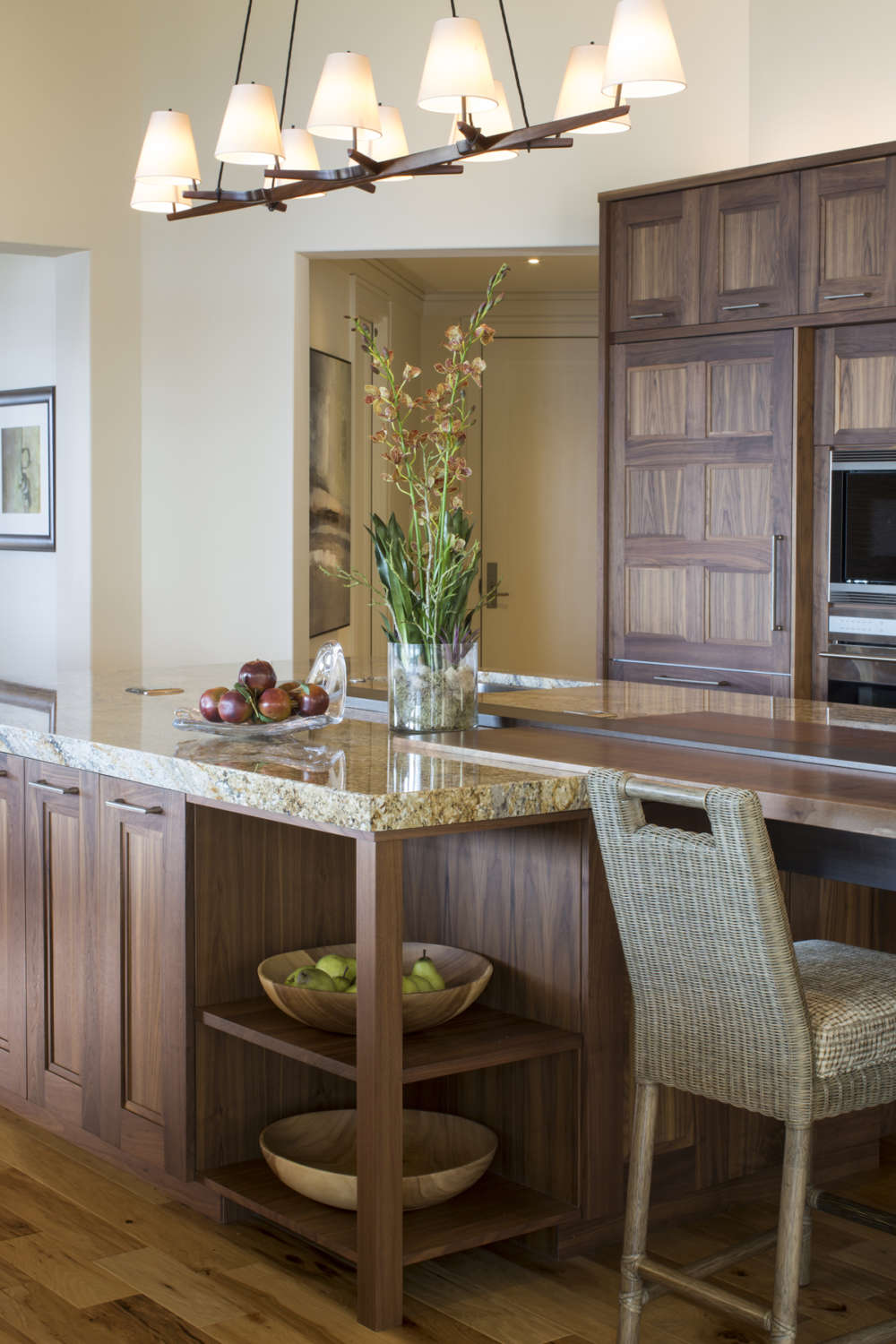 Transitional kitchen features fully custom frameless, shaker style Rutt Recency cabinets in natural walnut and a large isalnd with seating. The warm-toned granite complements the graining of the walnut cabinets. Design by RitaLuisa Garces of Bilotta Kitchens.