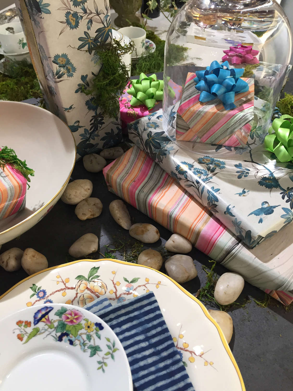 Wrapped presents and botanical printed plates in an Art of the Table tablescape.