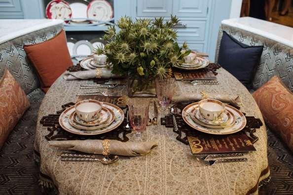 Oval table set with embroidered table cloth and Herend China on wood place mats