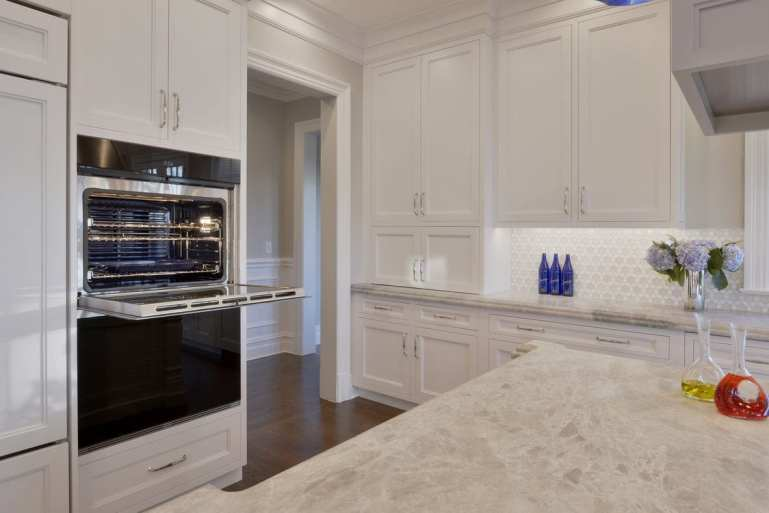 Double wall ovens in a classic white kitchen.