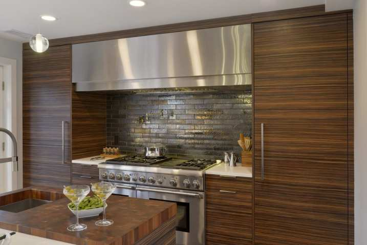 Contemporary Kitchen Hearth with Stainless Hood