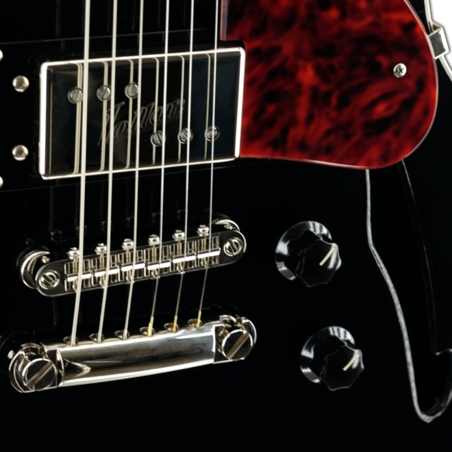 Body Detail, Black Volaré with Tortoise Pickguard