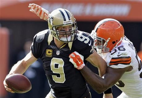 Karlos Dansby, Drew Brees