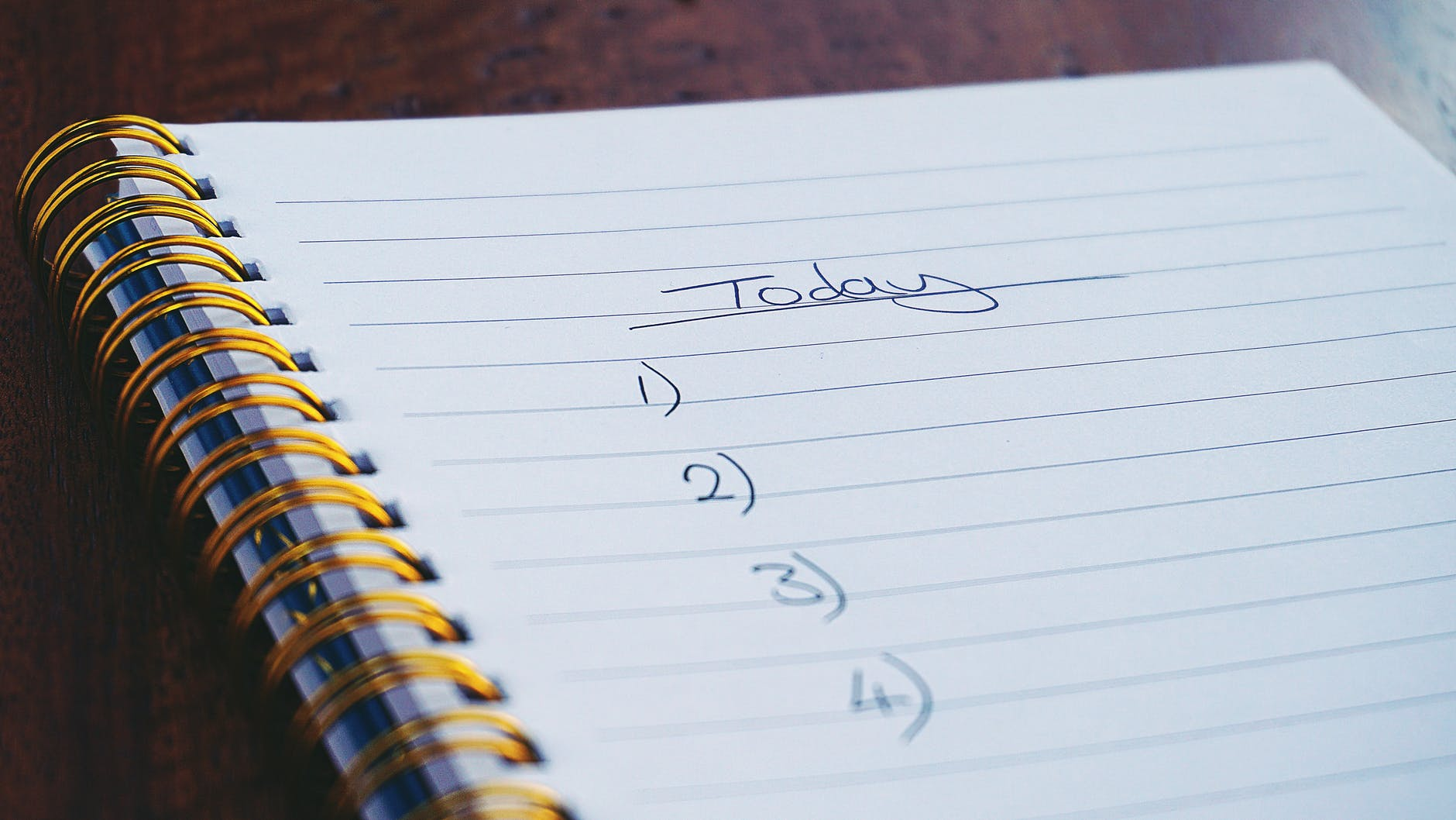 notebook with four blank tasks for today