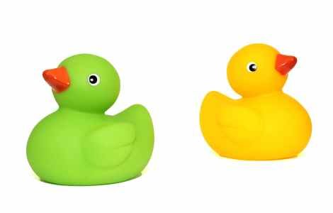 yellow duck toy beside green duck toy