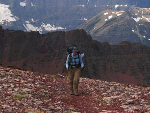 A hiker crosses Red Gap Pass.
