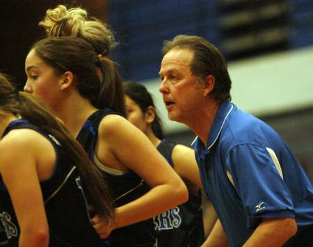 Bingham's Lady Miners coach, Rand Rassmussen, gets his team in a huddle during a game.
