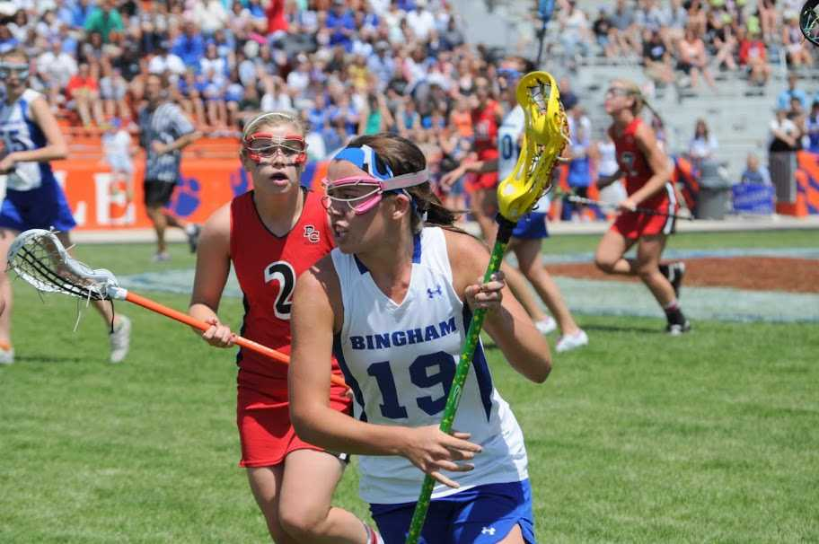 Morgan Judd (19) looks to the goal as she defends her cradle from the opposing Park City player during last year's state championship.