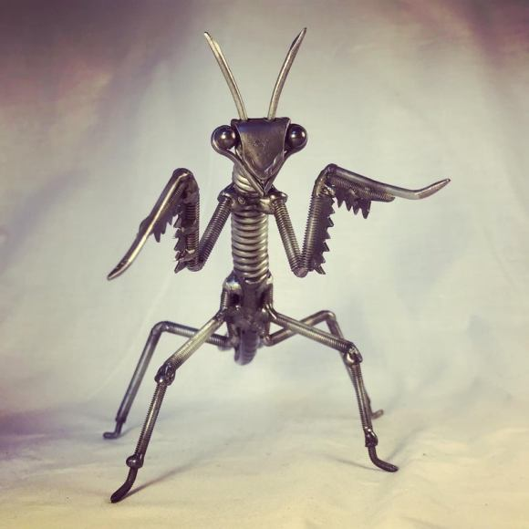 Scrap metal Praying Mantis Sculpture. Created by JTLMetalArt.