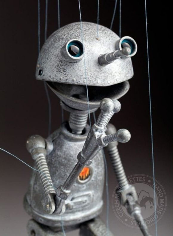 On, The Vintage Styled Retro Robot Stringed Puppet.Photos credited to CzechMarionettes (Czech Marionettes).