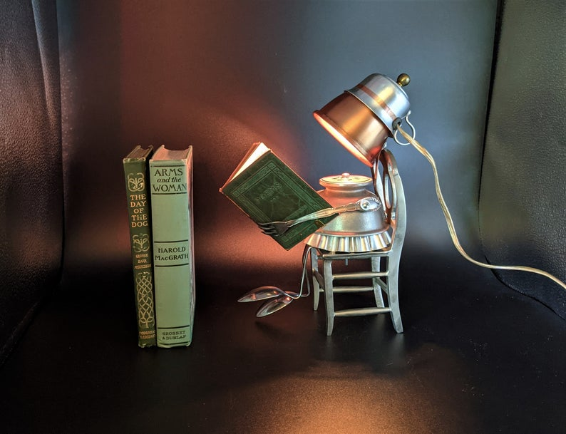 Paige The Girl Reading A Book Lamp. An upcycled steampunk Robot lamp. Created By Amy Alison Knutson of Vintage Android Art.