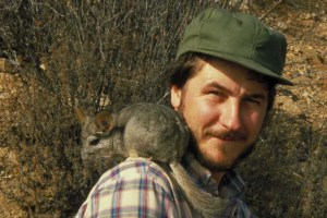 Researcher with wild chinchilla, Chile.