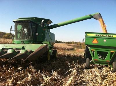 John Deere combine harvesting corn.
