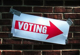 """Sign showing: """"Voting this way"""" by Keith Ivey via Flickr."""