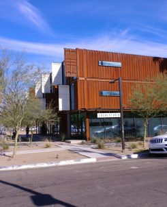 Old rusty shipping containers are converted into a building.