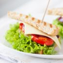 Homemade tasty vegetarian sandwich with fresh vegetables and cheese, closeup, selective focus