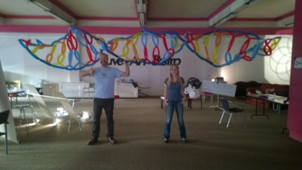 Natasha and Andy under a balloon model of DNA at ASMbly 2014.
