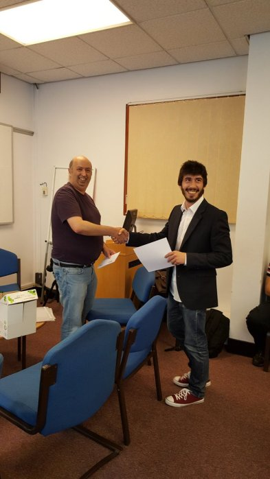 Nacho receiving his oral presentation prize from Dr John Wilkie, organiser of the event