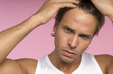 young-man-checking-his-hair