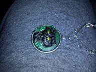 Close up of handpainted pendant for Nat
