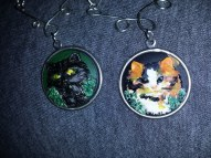 Close up of hand painted pendants for Nat