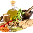 Spices, herbs, salt, olive oil and mortar with pestle isolated on white background.