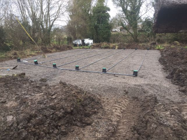 The finished percolation area with piping, ready for membrane covering