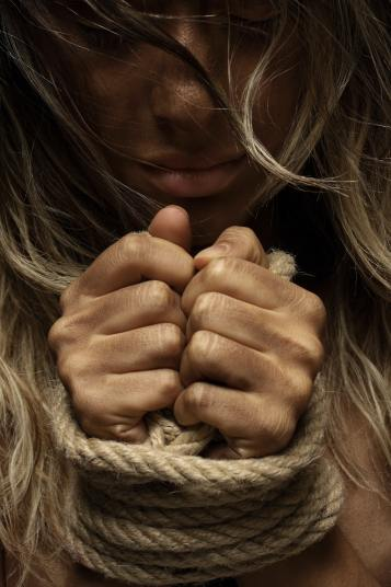a content soul: image of woman with bound wrists