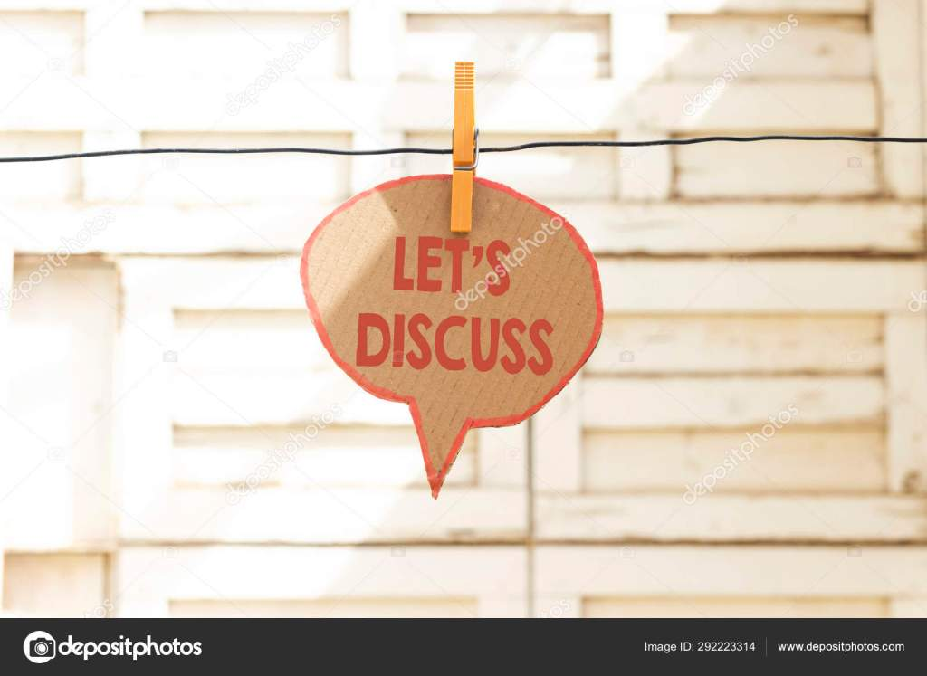 Picture of a sign that says let's discuss hanging from a wire