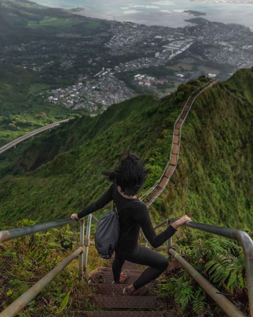 Woman descending steps on a mountaintop