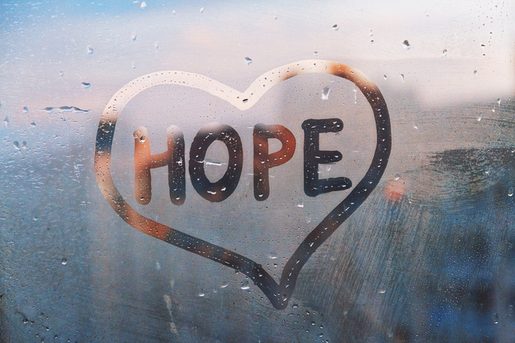 Hope written on Foggy glass on window