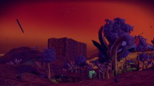 A nighttime scene on a red-orange world. (Image credit to Birb Friends, retrieved from No Man's Sky using PlayStation Share)