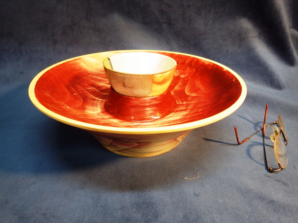 This bowl was made from a dying Alaska Spruce tree. It has to be taken down so the bowl represents not only the tree but the vibrant colorss reflect the active family's lifestyle. They love it, too.