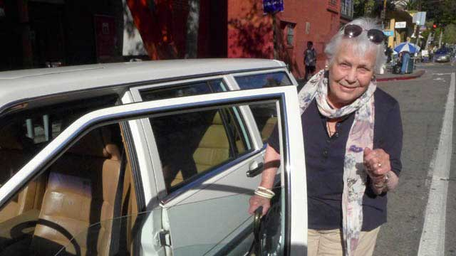 Jean w her white Volvo wagon