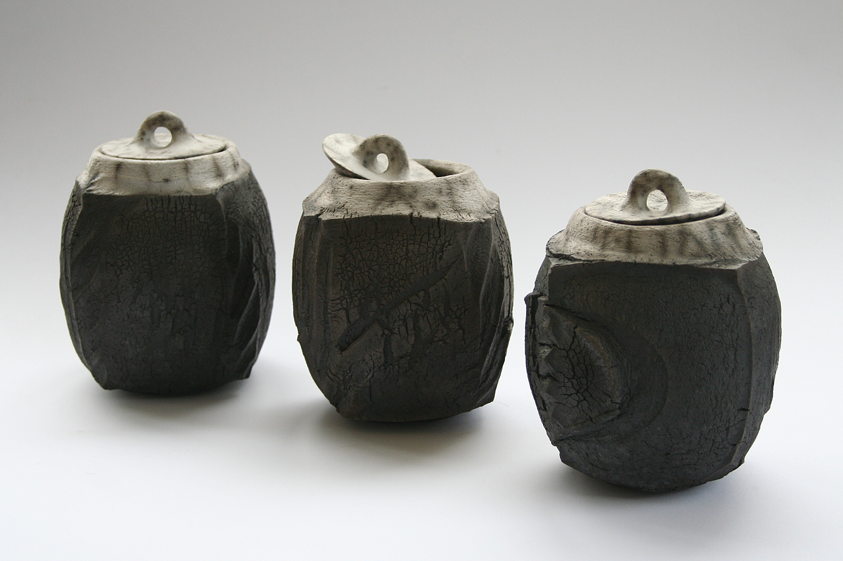 Patricia Shone. Lidded jars raku ceramic fired ht14cm