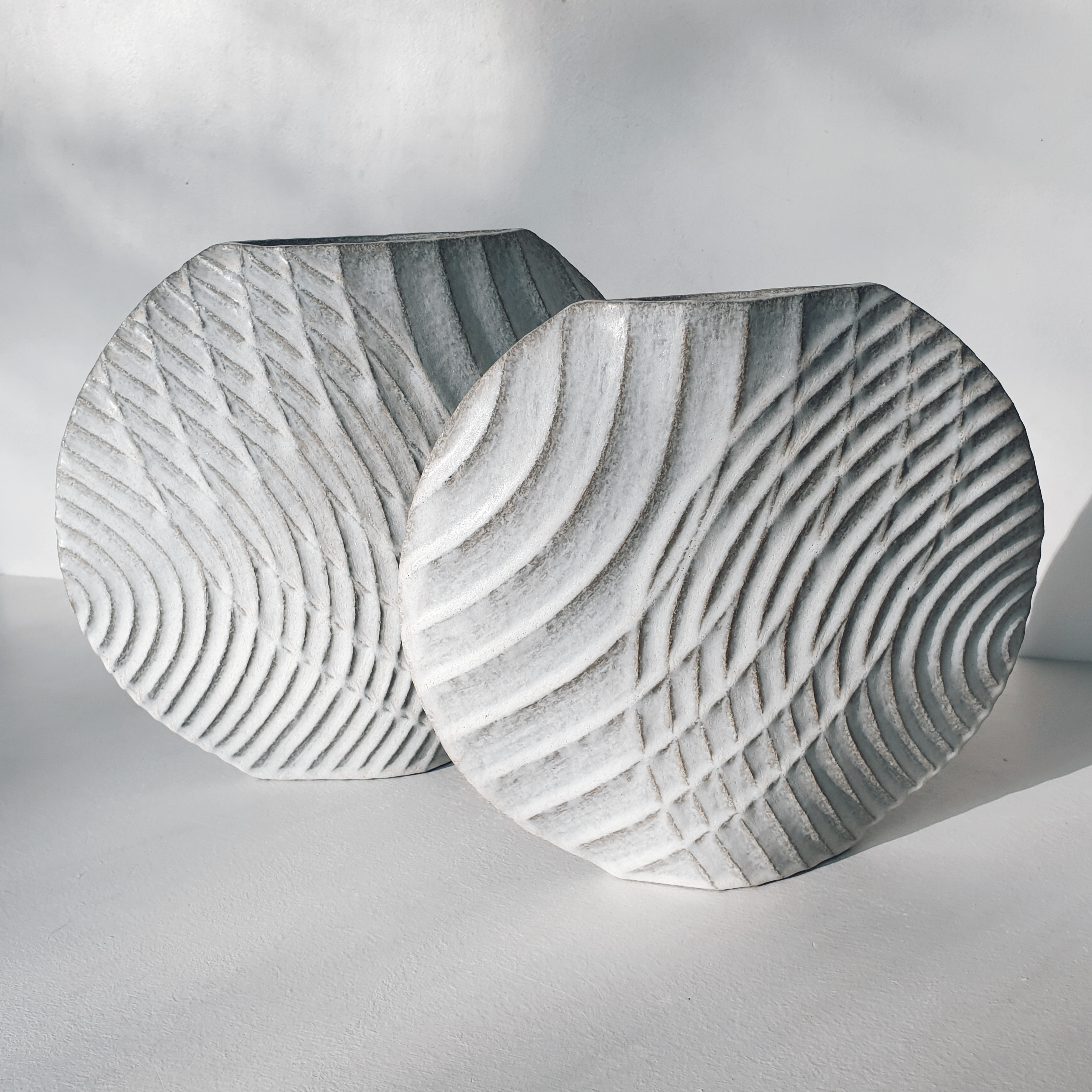 Michele Bianco. Carved 'Disc' Overlap vessels