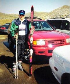 Hubby near SUV with skis Park City