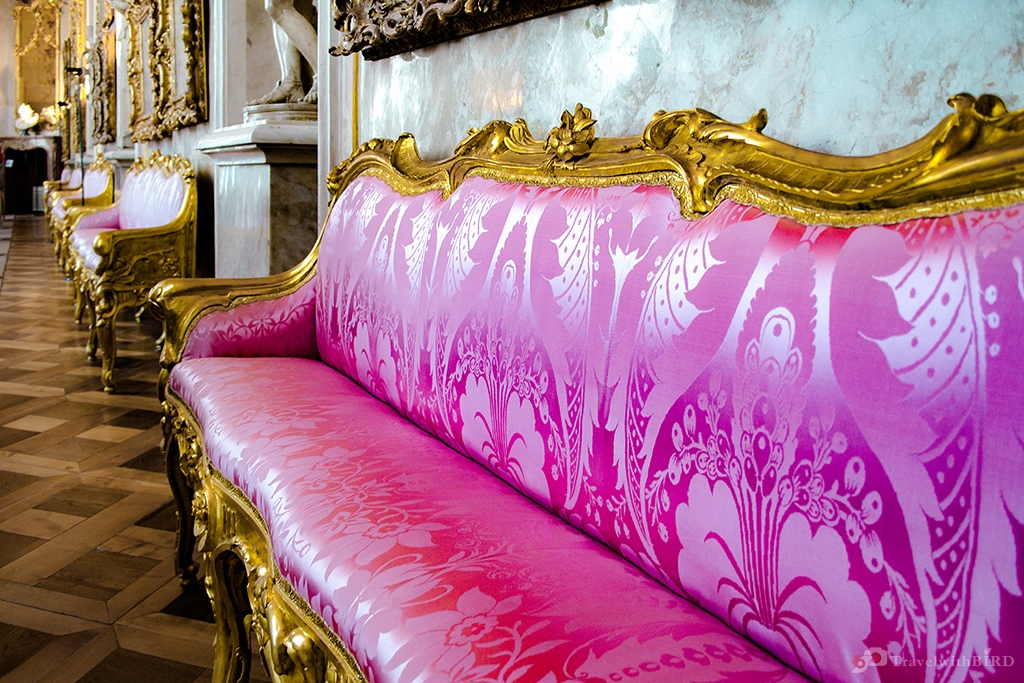 Purple sofa in the Entrance hall of Sanssouci