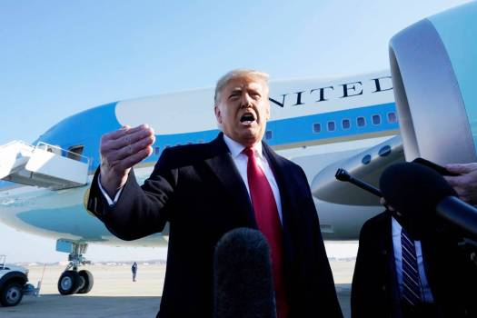 President Donald Trump speaks to the media before boarding Air Force One, at Andrews Air Force ...