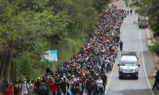 Migrants hoping to reach the U.S. border walk alongside a highway in Chiquimula, Guatemala, on Jan. 16, 2021. (Sandra Sebastian/AP Photo)