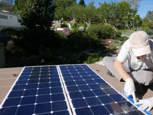 Installing the solar panels (From Starlight Solar)