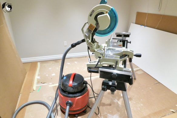 To keep the dust down while cutting indoors, connect a shop vac to the mitre saw.