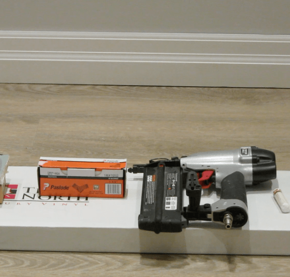 Box of Paslode 18 gauge finish nails shown with Porter Cable Pneumatic Air Nailer