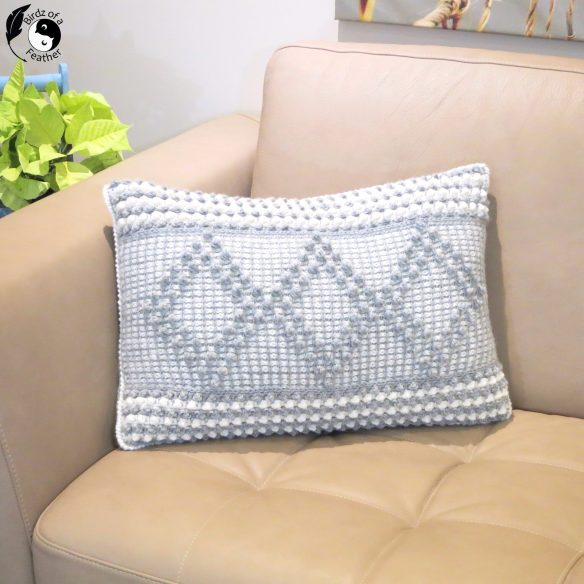 Learn how to make the Kayla crochet pillow cover: 100% benefits Alzheimer's! Birdz of a Feather | Tunisian crochet | Tunisian crochet stitches | Tunisian crochet patterns | Tunisian crochet pillow | Tunisian crochet pillow cover | Tunisian crochet pillow pattern | crochet pattern | crochet pillow cover | crochet patterns for beginners | crochet pattern tutorial | crochet pattern videos | crochet pattern tutorial stitches | Tunisian crochet patterns free | smock stitch | smock stitch crochet