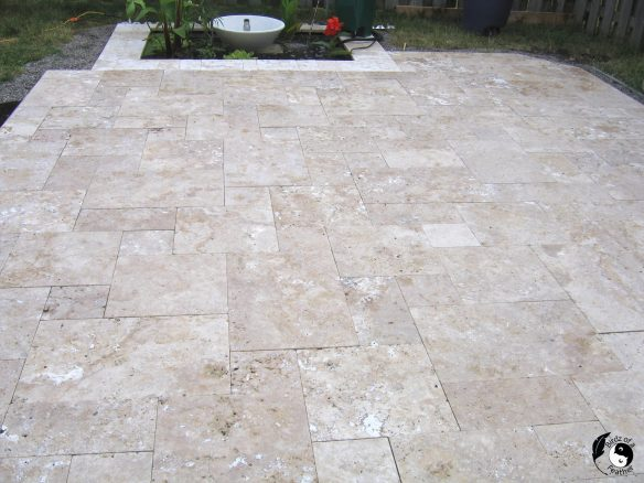 A stone patio installation is likely the most backbreaking work you will ever do. But it's also the most rewarding DIY! Birdz of a Feather | patio installation diy | stone patio installation | patio installation ideas | travertine patio | travertine patio backyards | travertine patio ideas | travertine patio pavers | outdoor travertine patio | outdoor travertine pavers  outdoor travertine | outdoor travertine tile | polymeric sand | patio stones backyard | patio stone ideas | patio stone deck